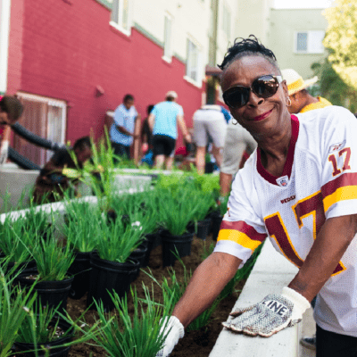 Woman gardening at community garden event